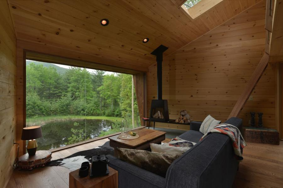 cabin, wooded, wood, pond, lake, glass, fireplace,